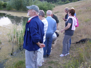 The group looking southwards over the balancing pond in the country park